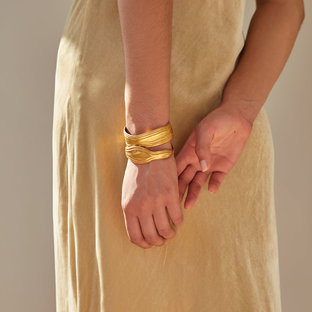 Textured 18ct Fairtrade yellow gold bangles with polished gold ripples
