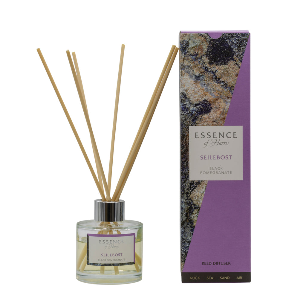 Clear glass reed black pomegranate diffuser with Seilebost scented liquid with natural reeds packaged in our Essence of Harris purple Seilebsot diffuser box