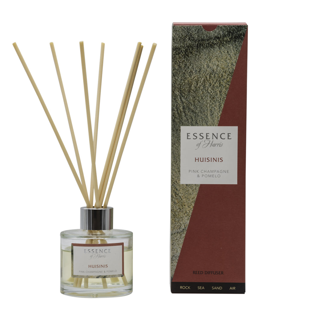 Clear glass reed diffuser with Huisinis scented liquid with natural reeds packaged in our Essence of Harris Huisinis diffuser box
