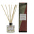 Clear glass pink pomelo reed diffuser with Huisinis scented liquid with natural reeds packaged in our Essence of Harris Huisinis diffuser box