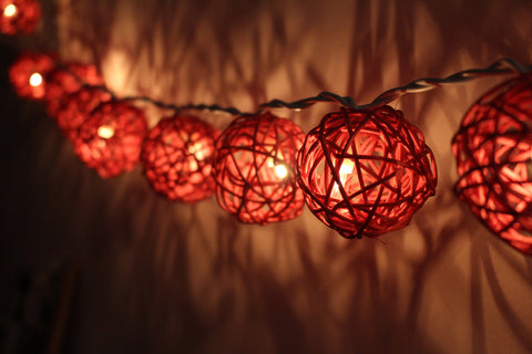 Lit up dusty rose rattan ball fairy lights - in the dark