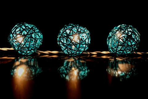 Lit up royal blue rattan ball fairy lights - in the dark