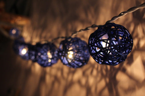 Lit up navy blue rattan ball fairy lights - in the dark