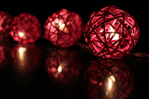 Lit up violet rattan ball fairy lights - in the dark