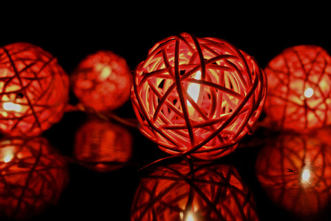 Lit up blood orange rattan ball fairy lights - in the dark