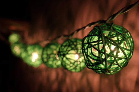 Lit up green rattan ball fairy lights - hanging