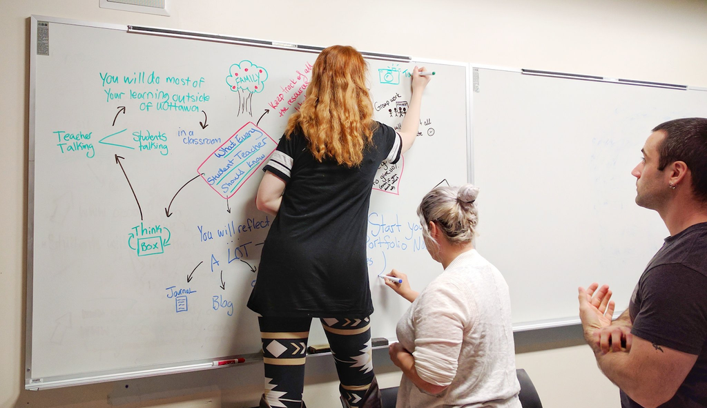 student_working_problems_math_whiteboard