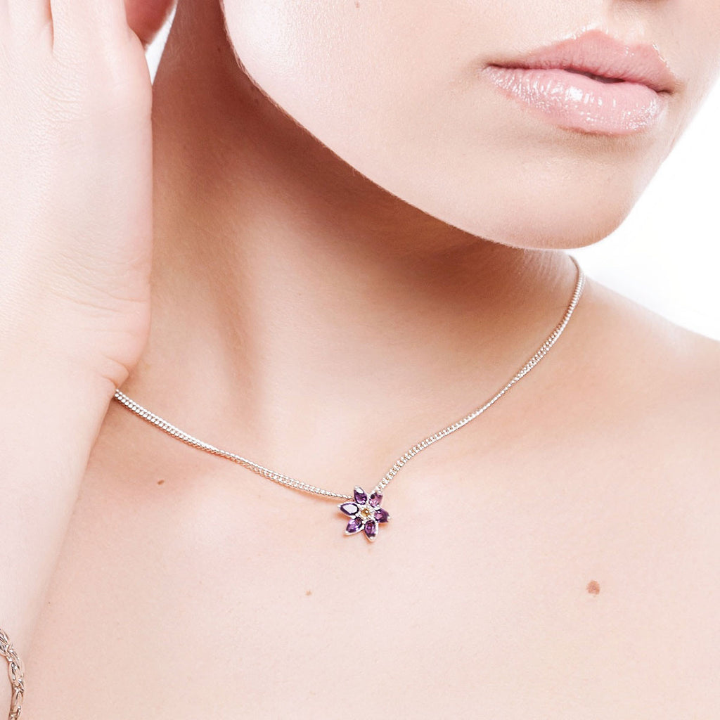 On body image of silver and amethyst flower necklace