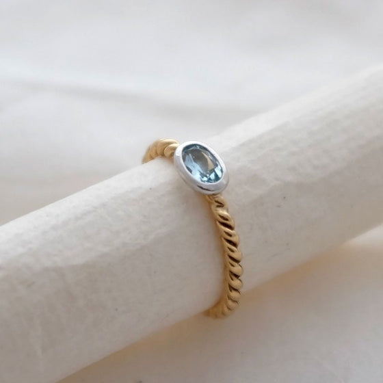 Gold Aquamarine twist ring with white gold setting