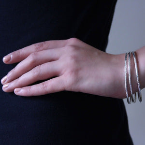 Fine silver bangle textured on body image