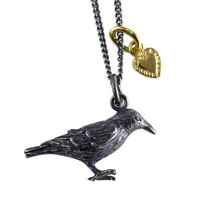 Dark silver raven necklace with a gold vermeil tiny heart