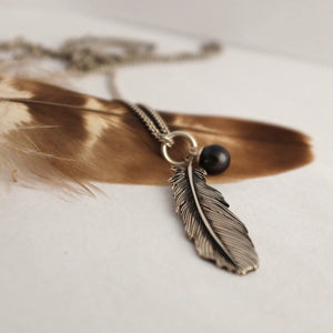 Silver Buzzard Feather & Black Pearl Necklace by Joy Everley