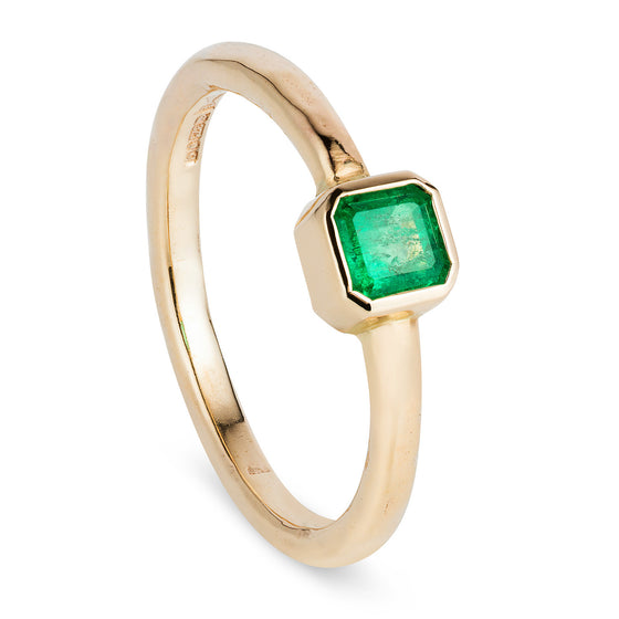 Bespoke cushion cut emerald ring in 9ct yellow gold