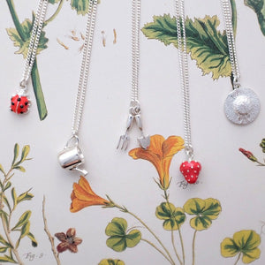 Set of silver and enamel gardeners charm necklaces
