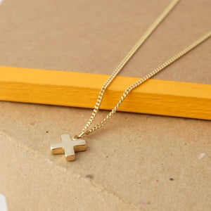 Solid Gold Kiss Cross Necklace by Joy Everley