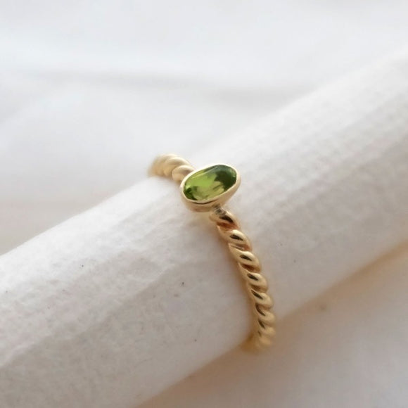 Gold peridot twist ring