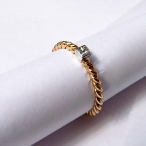 9ct gold twist ring with princess cut diamond