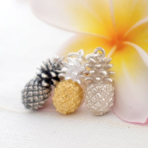 Trio of pineapple charms in dark silver, gold vermeil and silver