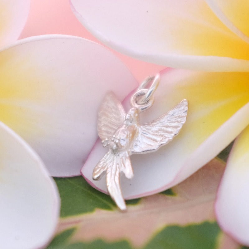 Silver flying parrot charm