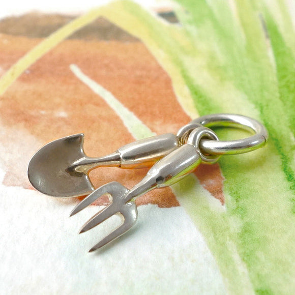 Silver fork and trowel charm