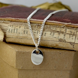 Silver Flat Pebble Tag Necklace by Joy Everley
