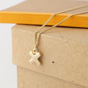 Solid Gold Kiss Cross Necklace