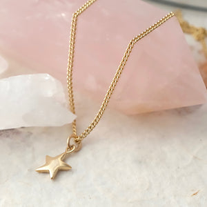 Solid Gold Tiny Star Necklace by Joy Everley