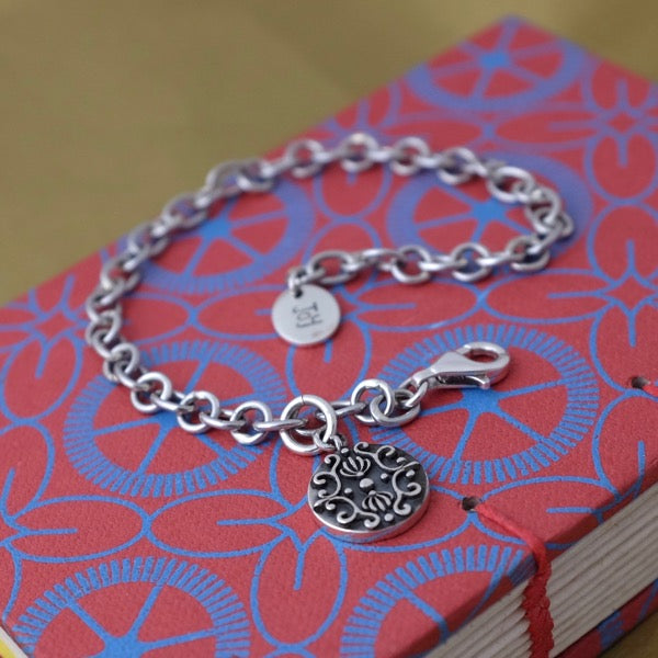 Silver Bracelet with Dark Baroque Tag by Joy Everley