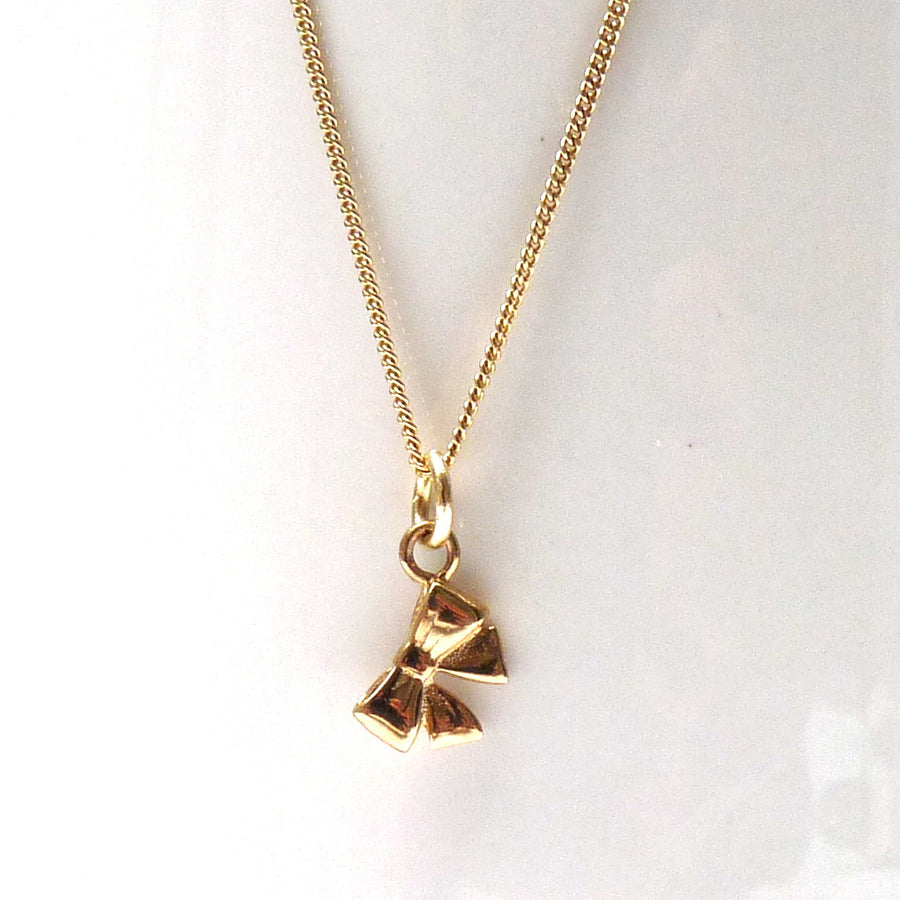 Solid Gold Tiny Bow Necklace or charm by Joy Everley