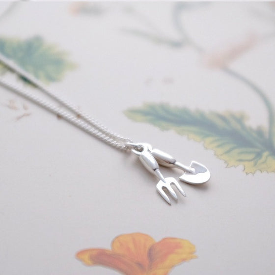Silver fork and trowel charm necklace