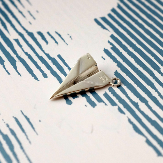 Paper Plane Charm - Joy Everley Fine Jewellers, London