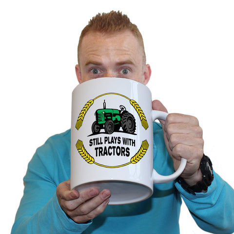 Funny Mugs - Still Plays With Tractors - Joke Birthday Gift Birthday Pun GIANT NOVELTY MUG