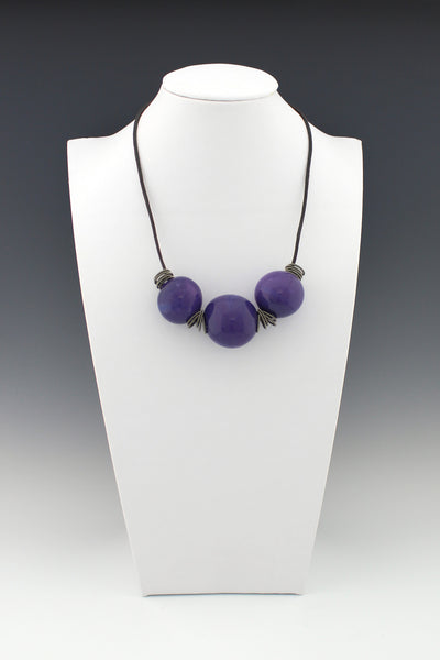 Purple Hollow Lampwork Beads on leather with Italian springs