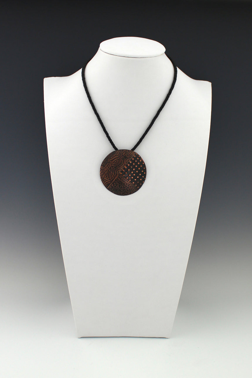 Multi-textured Copper Pendant on African Phono Vinyl Beads