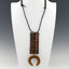 Long Ethnic inspired Copper Pendant with Bone Talisman