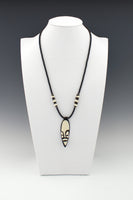 Ebony and Ivory (not real) Bone  inlaid pendant on African Phono Vinyl Beads.
