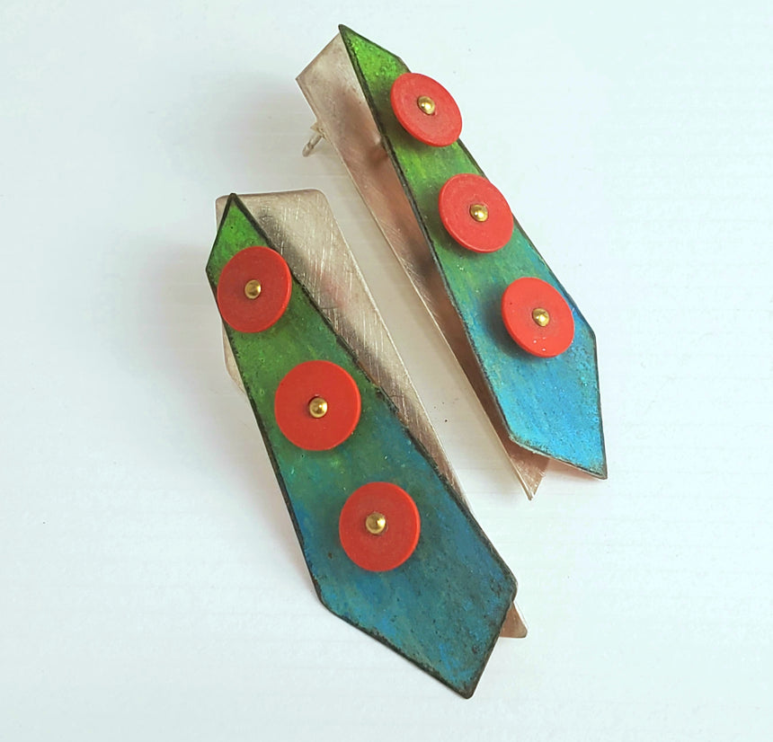 Bright tropical colored  blue and green Prisma colored crayon is blended onto copper sheet.  These is then riveted onto sterling silver and has an accent of three bright red African record beads to create a three layer pair of earrings.