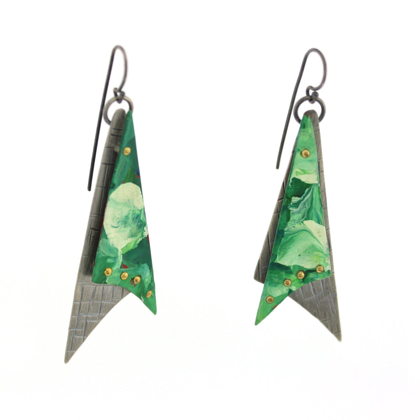 Triangles with tails in copper are painted in swirls of green and white acrylic paint.  These are then riveted to opposing hammered sterling silver with a back/gray patina creating two dimensional earrings.  These hang from hand made french wires making them kinetic.