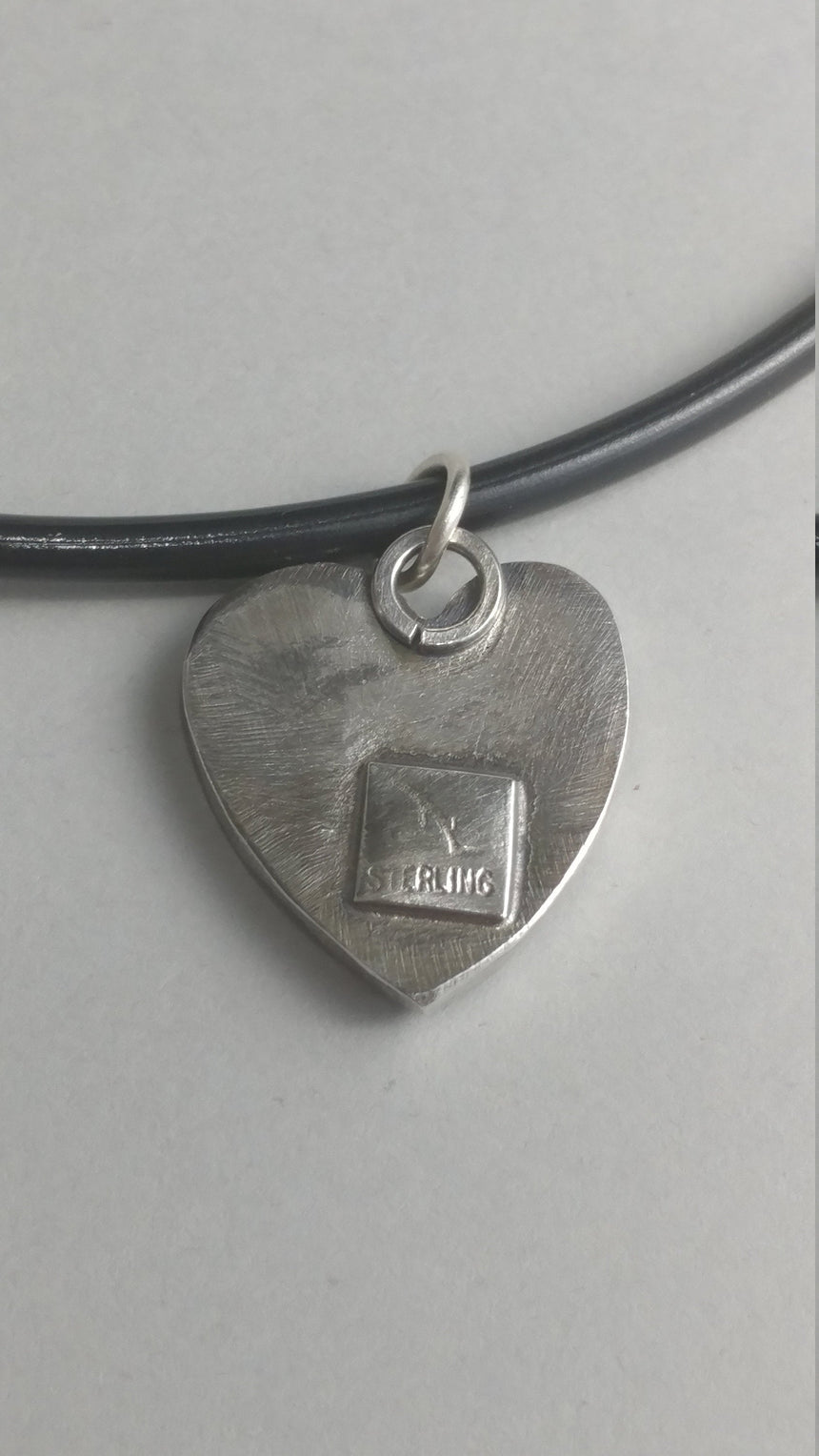 Reclaimed Silver Heart on Heart Pendant on a Leather Cord with silver clasp