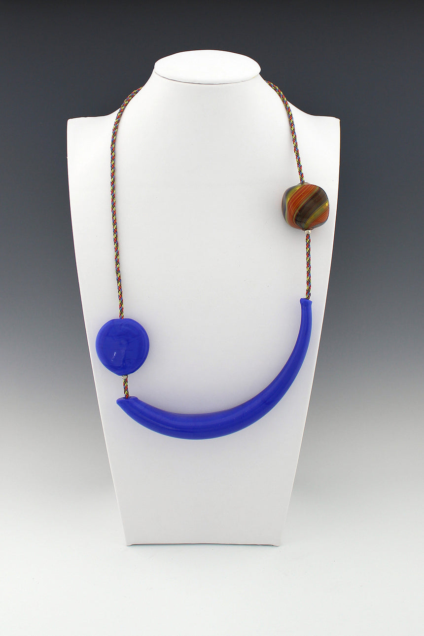 Royal Blue Hollow Bead and Square Multi-colored Bead on hand woven multi-color Kumihimo necklace, silver cones and hook closing