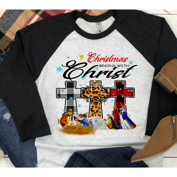 Christmas Begins With Christ on Black Sleeve Raglan (Fits True to Size)