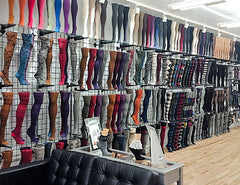 The inside of a showroom-type area displaying a variety of socks and tights stretched over mannequin legs.