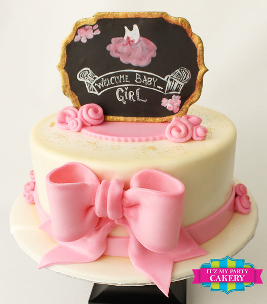Tutu sugar plaque topper with fondant rosettes and a pink bow
