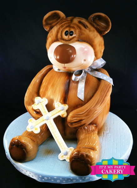 Sculpted Teddy Bear Cake holding a cross, perfect for a baptism or even birthdays or baby showers.