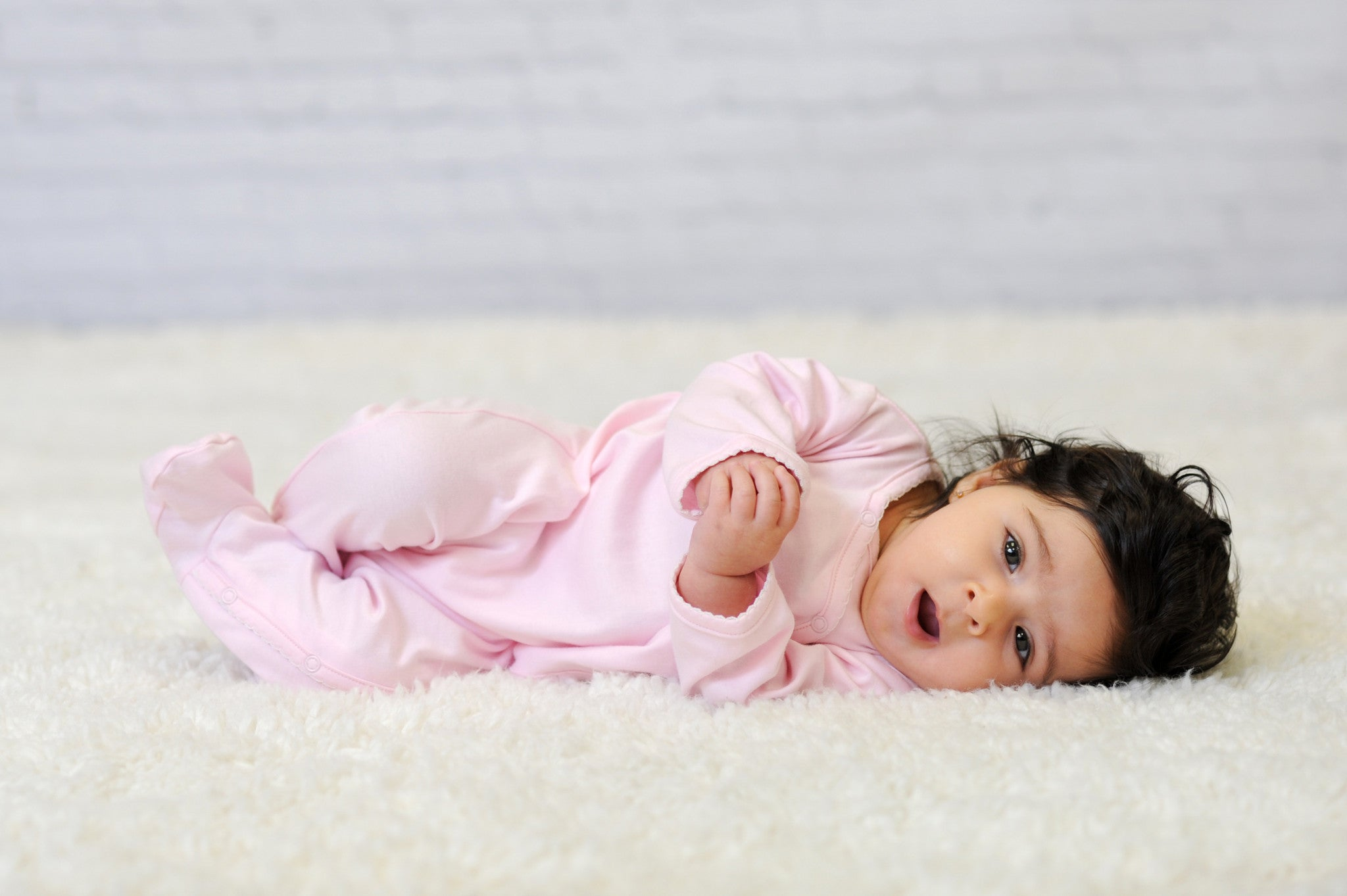 Baby Girl in Pink Side Snap Footie