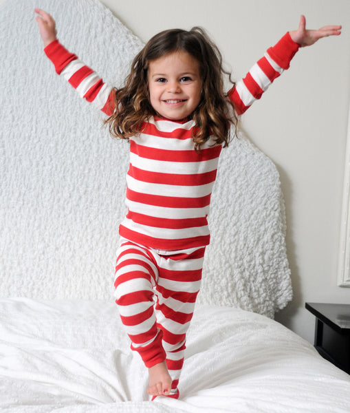 Girl Jumping for Joy in Red Stripe Long Johns