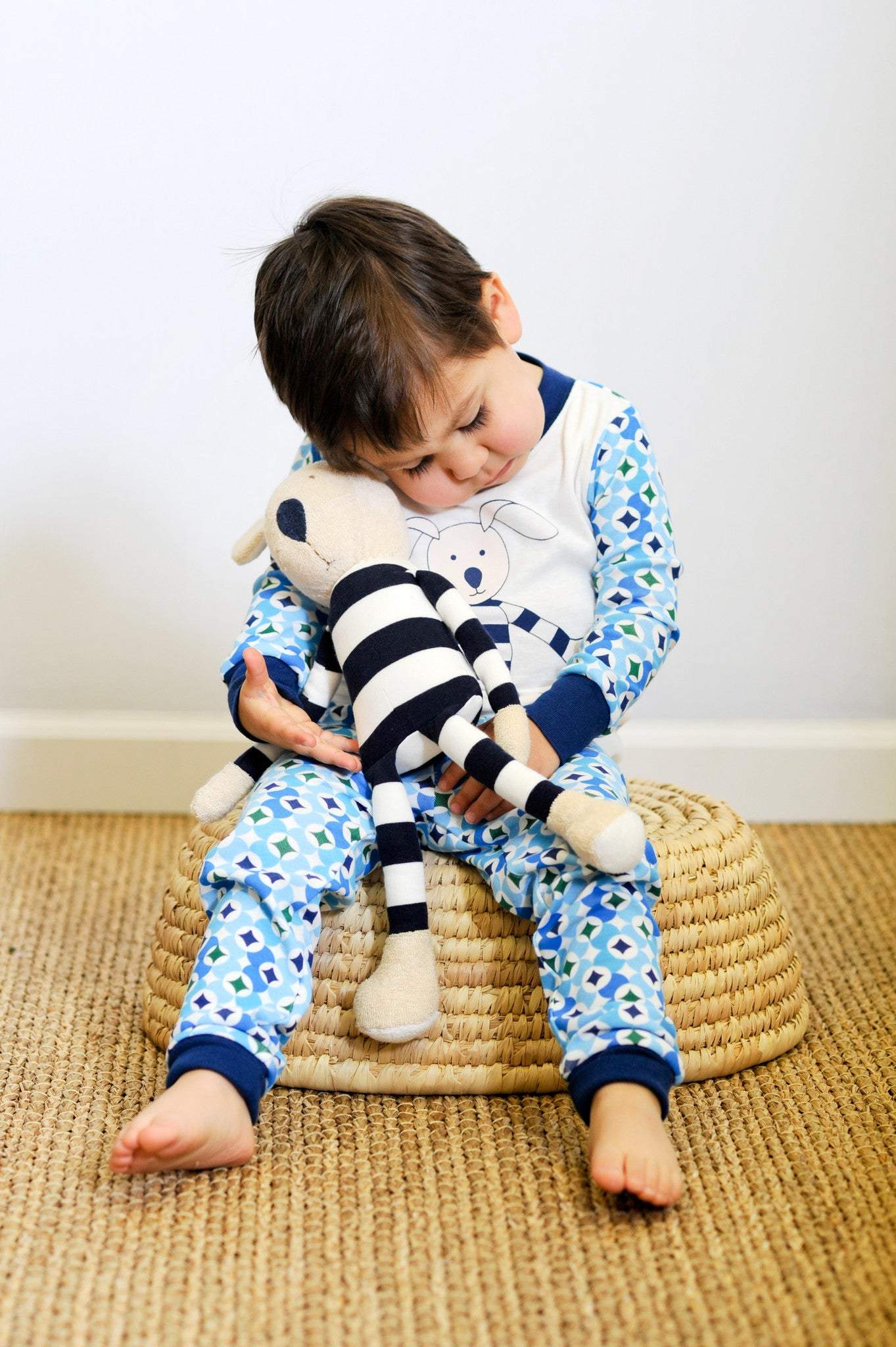 Cute child in Navy Prism Long Johns set, with Frankie the Fox