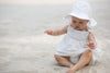 Baby girl in organic poplin sun hat