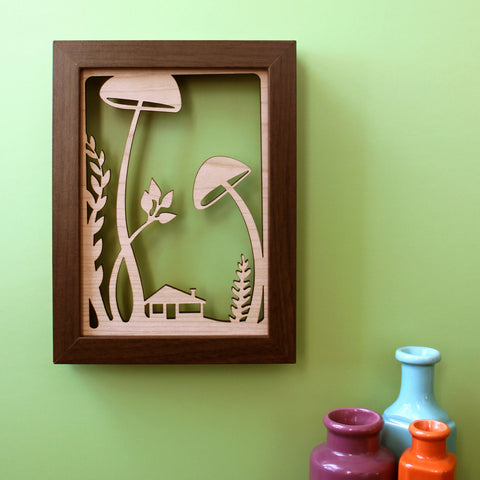 mushroom and fairy house 5x7 wall art for shadowbox laser cut by peppersprouts shown framed in wood frame, woodland forest floor illustration paper cut