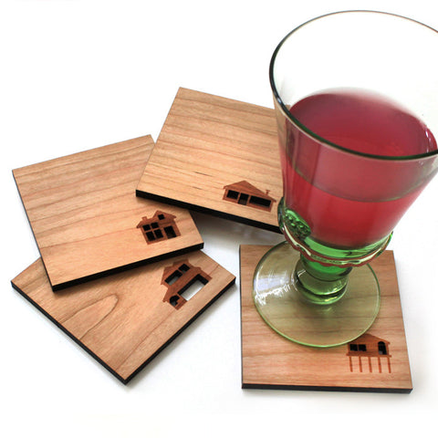 house illustration silhouettes wood coasters set of 4 by peppersprouts shown with a drink